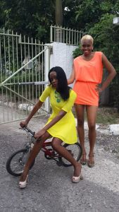 Left Yaneke White in a fashionable Modern Popping Yellow Dress
